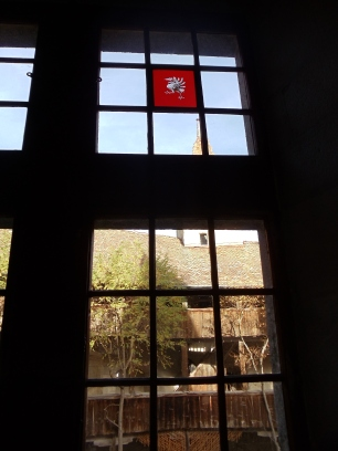 The symbol of the city on the top of the window